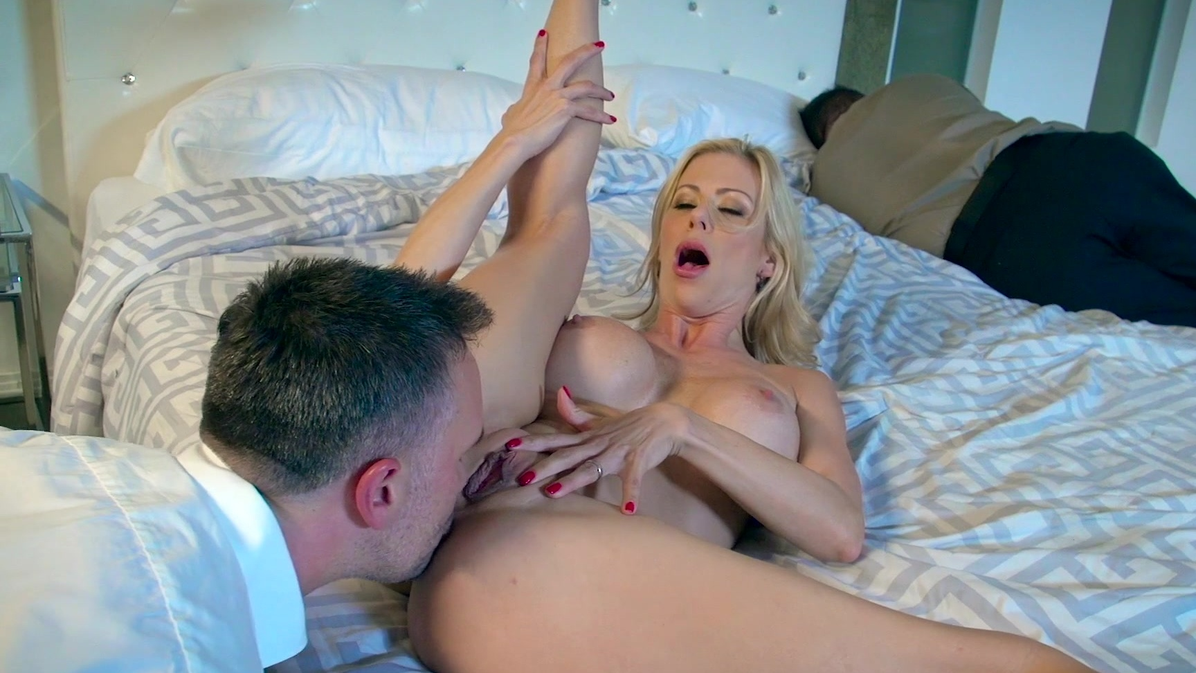 MILF Alexis Fawx fucked by room service next to sleeping husband