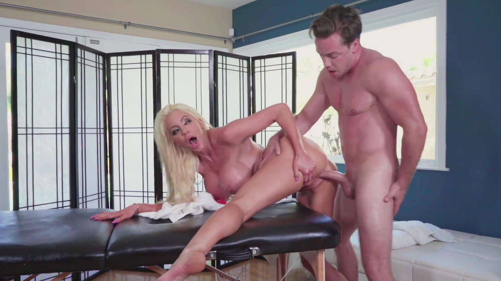 Nicolette Shea gets fucked on the massage table & sucks the dick off from  under